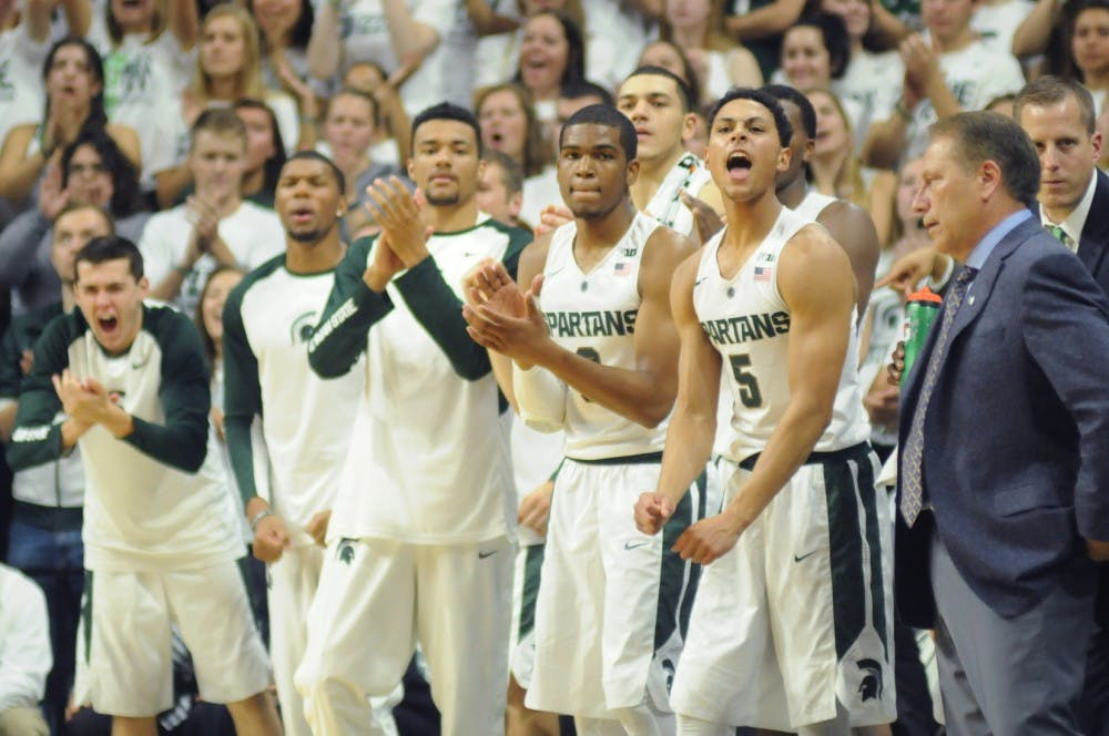 <p>Senior guard Bryn Forbes, 5, and the rest of the MSU Spartans get excited during the game against Northern Michigan on Nov. 4, 2015 at Breslin Center. The Spartans defeated the Wildcats, 94-53.</p>
