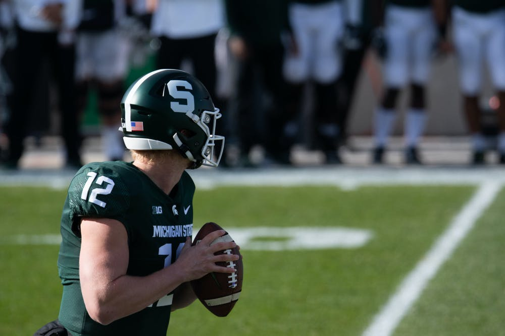 <p>MSU quarterback, Rocky Lombardi (12), looks to throw a pass during a football game against Indiana University at Spartan Stadium on Nov. 14, 2020.</p>
