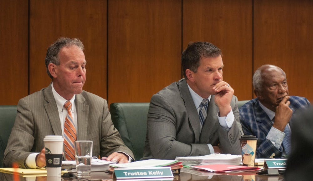 Left to right, trustees Dan Kelly, Mitch Lyons and Vice Chairman Joel Ferguson listen at the Action Meeting of Board of Trustees at the Hannah Administration Building on June 22, 2018.