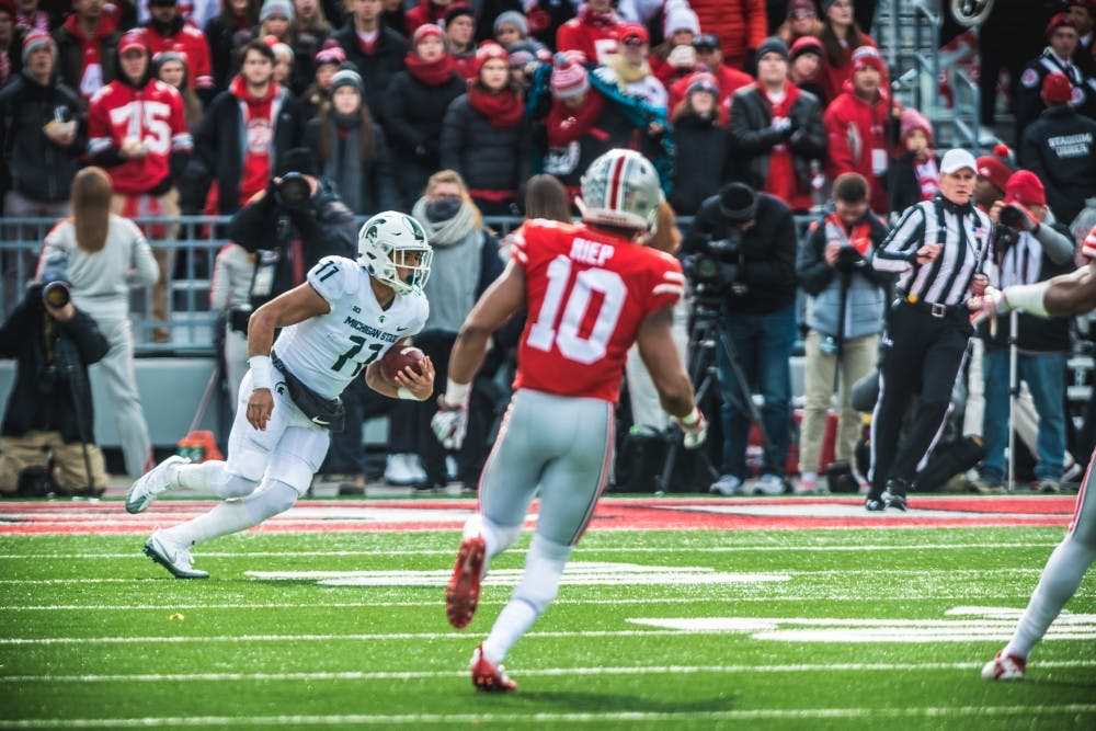 Freshman running back Connor Heyward (11) looks for open space during the game against Ohio State, on Nov. 11, 2017, at Ohio Stadium. The Spartans were defeated by the Buckeys, 48-3.