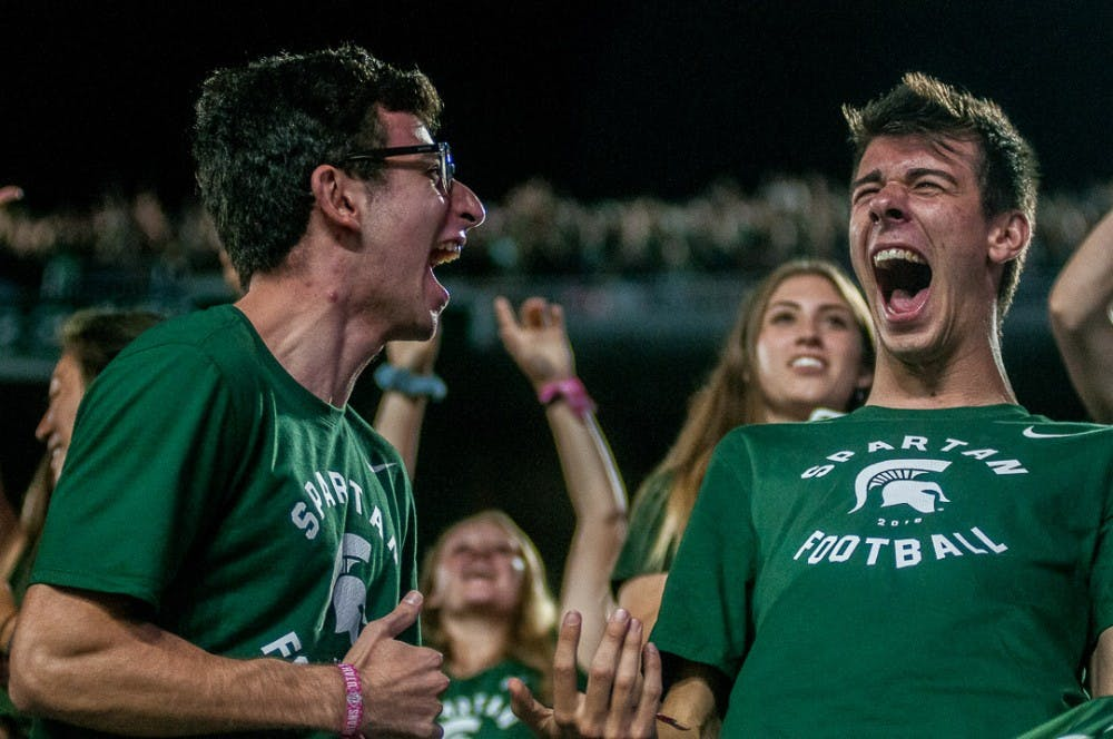 Microbiology and human biology junior Ali Kadouh and supply chain management junior Eric Dekoski react during the game against Utah State on Aug. 31, 2018 at Spartan Stadium. The Spartans beat the Aggies, 38-31.