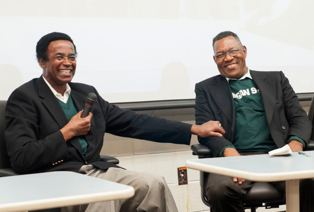 """<p>Former Michigan State wide receiver Gene Washington, left, and Clinton Jones share a laugh Sept. 10, 2015, at Conrad Hall, while talking about racial segregation in sports at a preview of Maya Washington's documentary """"Through the Banks of the Red Cedar.""""</p>"""
