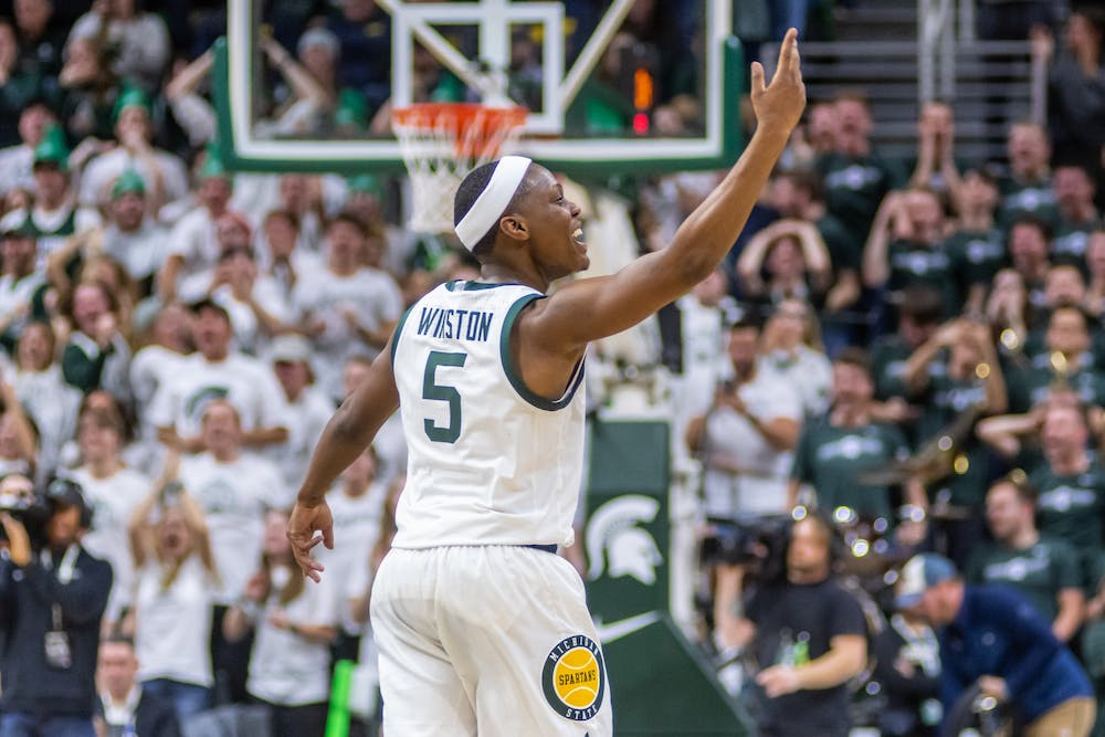 <p>Senior guard Cassius Winston asks for more noise after hitting back-to-back three pointers against Michigan.The Spartans defeated Michigan, 87-69, at the Breslin Student Events Center on Jan. 5, 2020. </p>