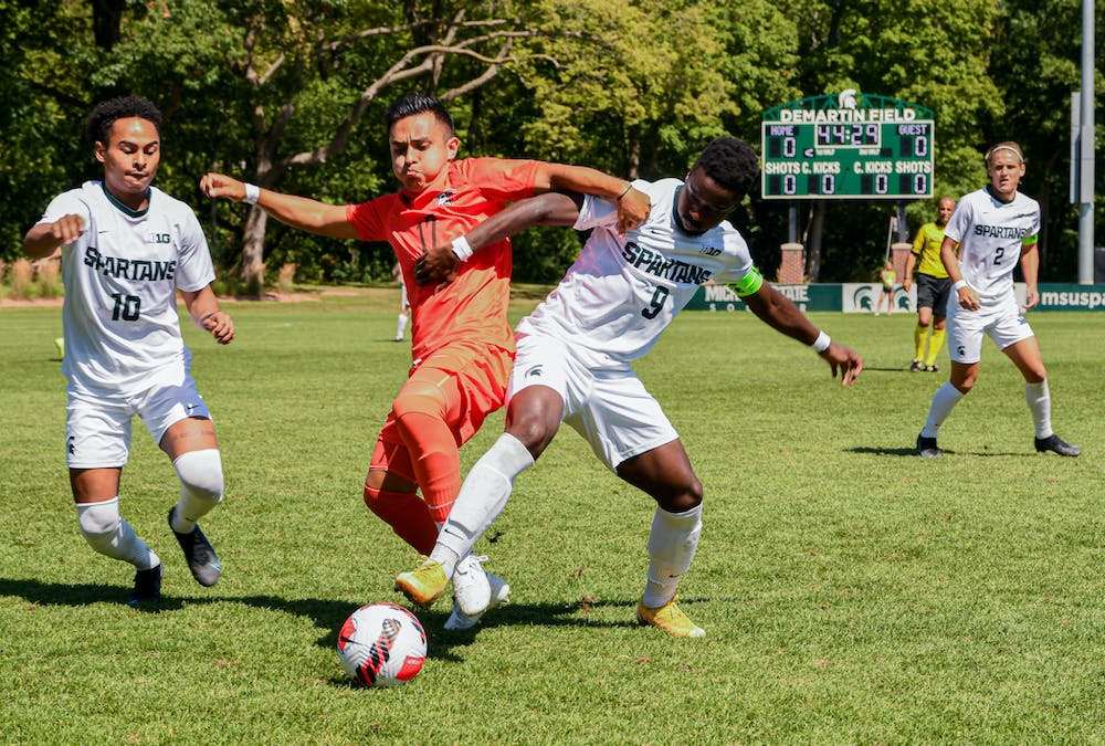 Senior forward Farai Mutatu fights for the ball near the sideline during the Spartans' 3-0 loss to Bowling Green on Sep. 6, 2021.