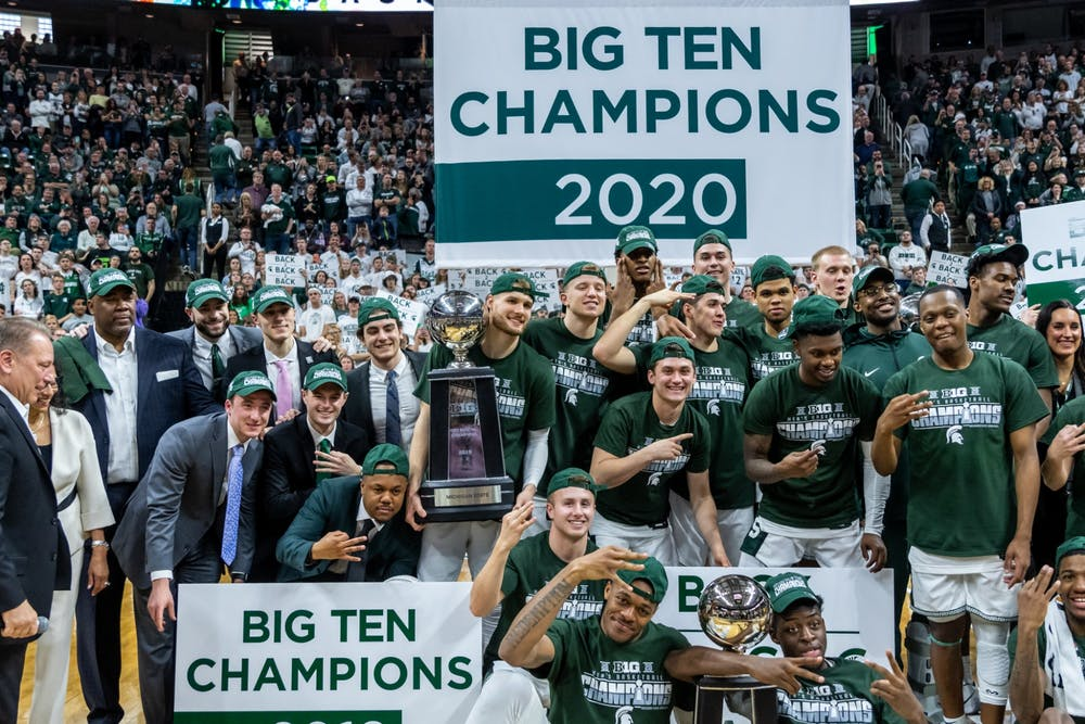 The Spartan basketball team poses for photos after winning a share of the 2020 Big Ten Championship. The Spartans defeated the Buckeyes, 80-69, at the Breslin Student Events Center on March 8, 2020.
