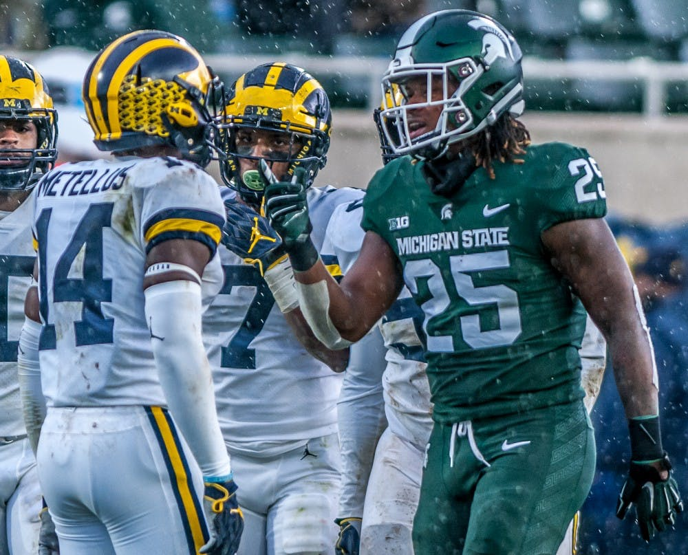 Junior wide receiver Darrell Stewart Jr. (25) points towards Michigan defensive back Josh Metellus (14) after a play during the game against Michigan on Oct. 20, 2018 at Spartan Stadium. The Spartans lost to the Wolverines 21-7.