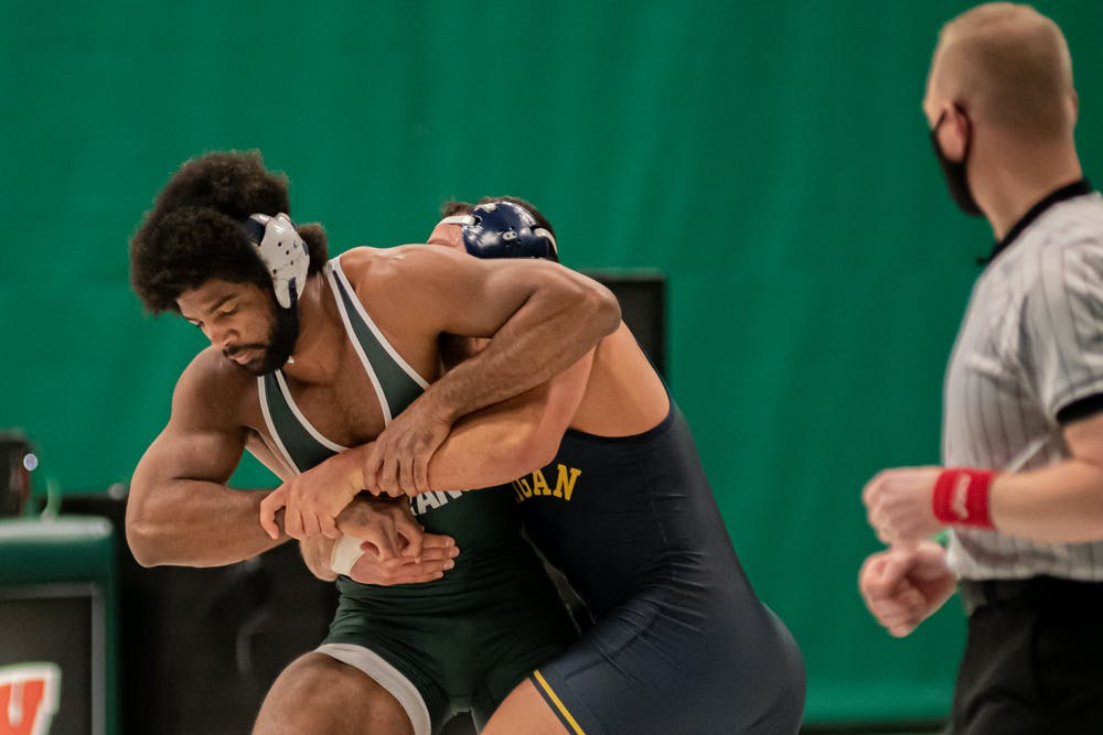 <p>Redshirt junior and No. 10 Cameron Caffey wrestles the No. 1 graduate student Myles Amine on Feb. 19. Caffey lost the match 11-6, dropping his record to 5-2.</p>