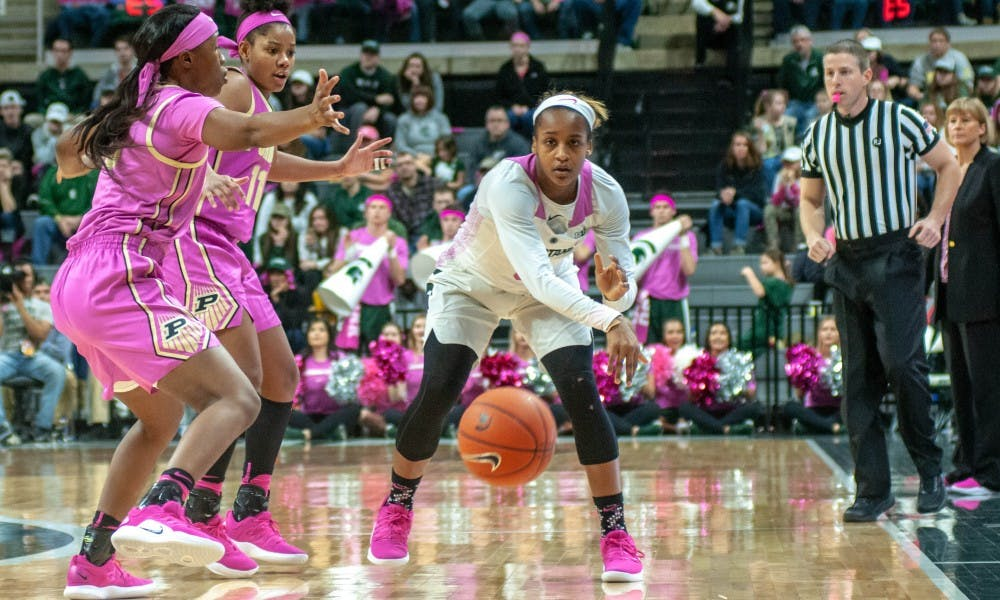 Redshirt-junior guard Shay Colley (0) passes the ball during the women's basketball game against Purdue at Breslin Center on Feb. 3, 2019. The Spartans lead the Boilmakers at halftime 39-26.
