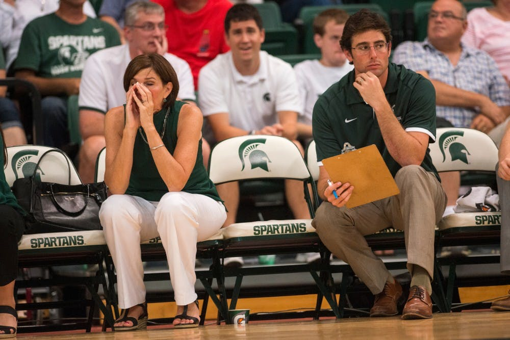 Head coach Cathy George rests her face in her hands during the volleyball game against the University of Florida on Sept. 4, 2016 at Jenison Field House. The Spartans were defeated by the Gators, 3-0.