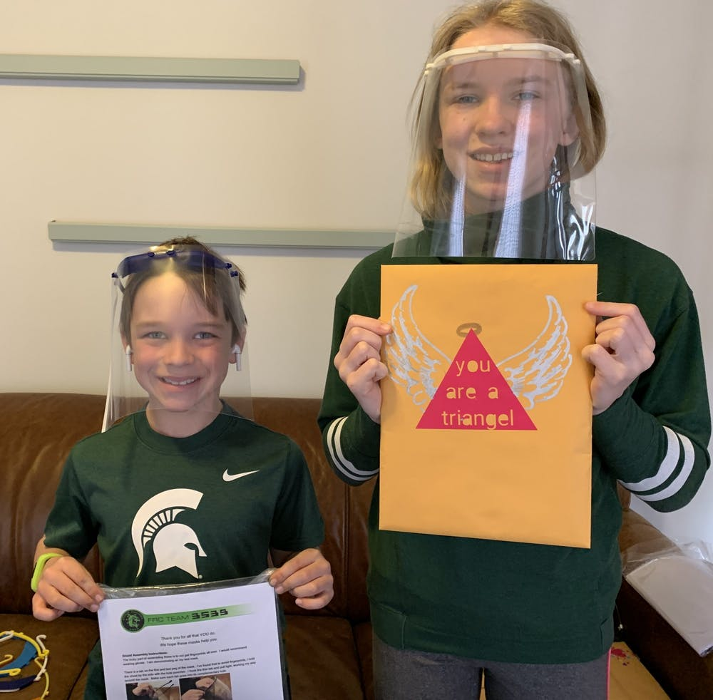 <p>Brayden and Harper Savage wear face shields printed by the FIRST Robotics team from Romeo High School. Photo courtesy Michael Savage.</p>