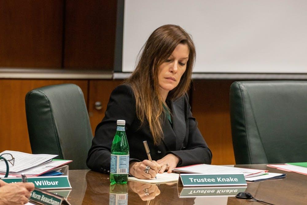<p>Trustee Renee Knake listens at the Board of Trustees meeting on Dec. 13.</p>
