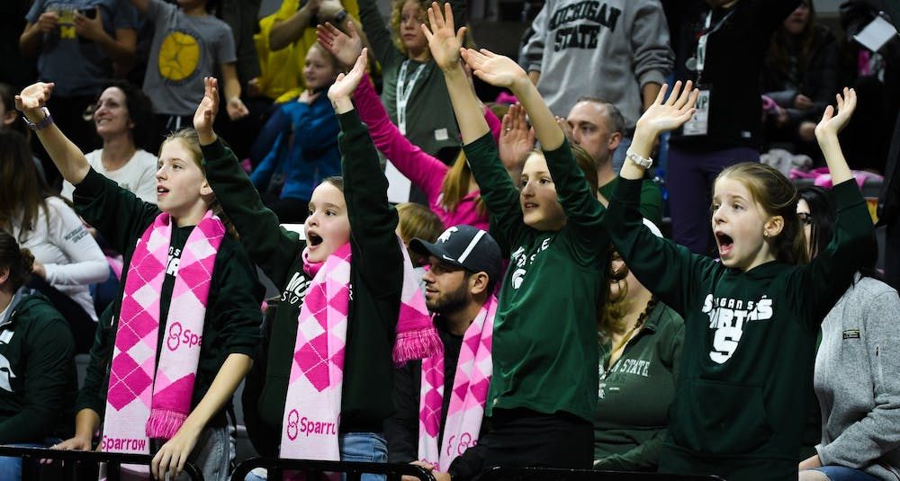 Young Spartan fans cheer during the women's basketball game against Michigan at the Breslin Center on February 23, 2020. The Spartans fell to the Wolverines 65-57.