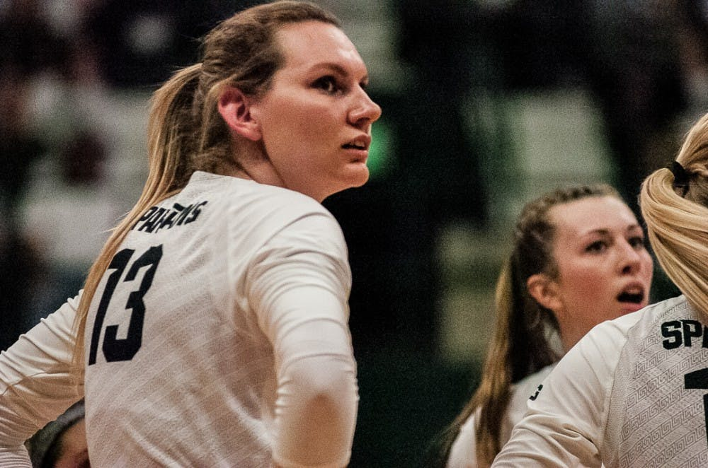 <p>Redshirt senior outside hitter Brooke Kranda (13) and teammates look at the referee after Michigan makes an out-of-bounds call during the game against Michigan on Oct. 18, 2017 at Jenison Fieldhouse. The Spartans secured a 3-1 win against the Wolverines.</p>
