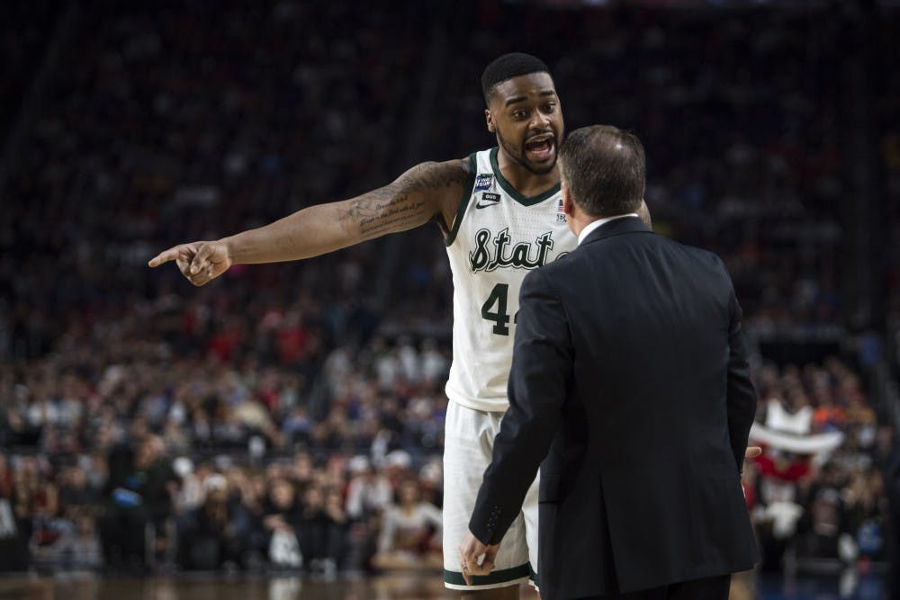 Junior forward Nick Ward (44) talks with Michigan State head coach Tom Izzo during the second half of the NCAA Final Four game against Texas Tech at U.S. Bank Stadium in Minneapolis on April 6, 2019. The Spartans lost to the Red Raiders 61-51.  (Nic Antaya/The State News)