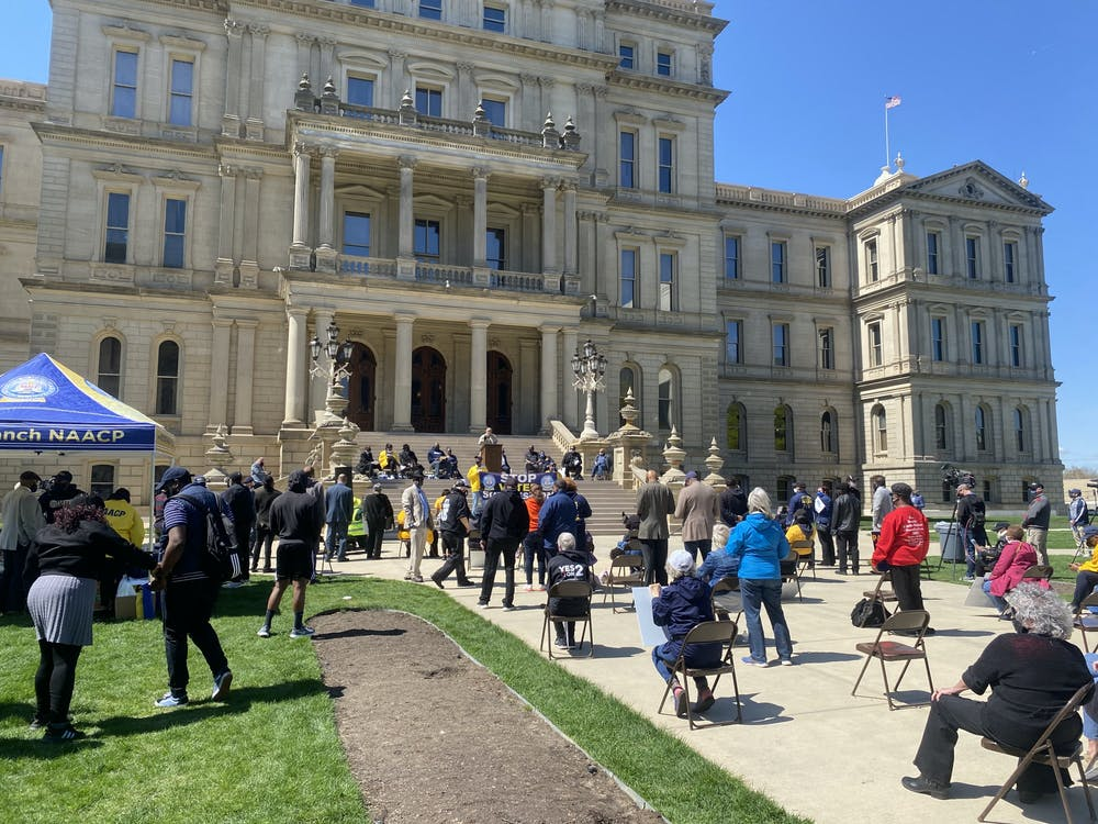 <p>Hundreds gathered on April 13 outside of the Michigan Capitol to protest against the proposed legislation to bring change to voting procedures in Michigan. </p>