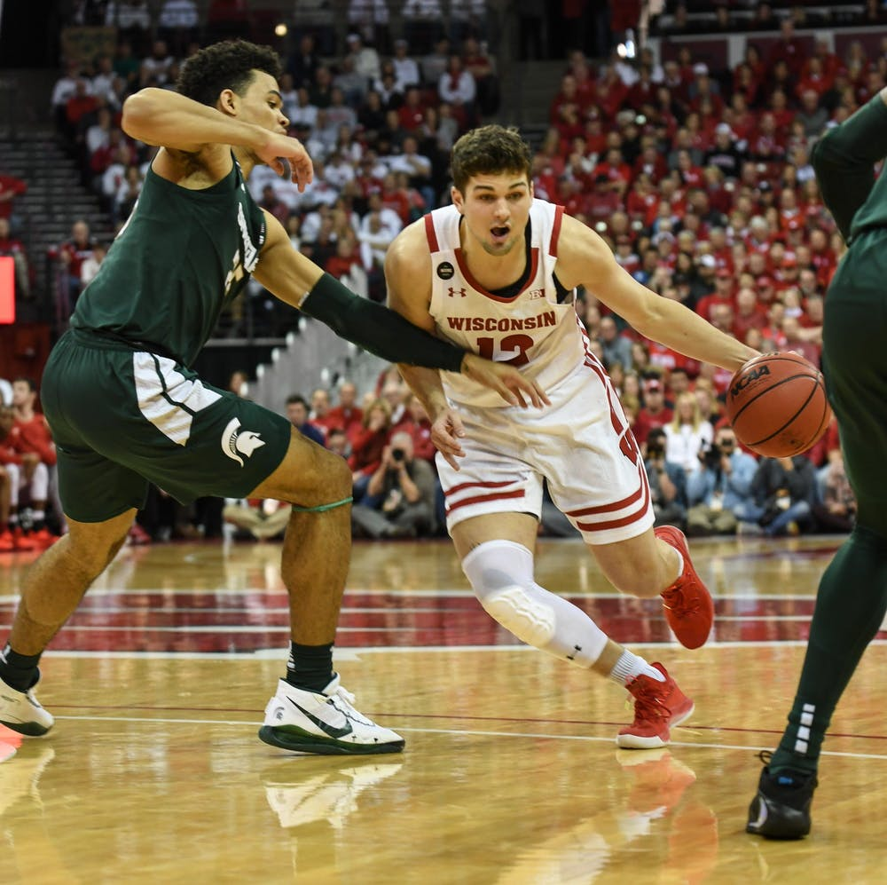 Freshman forward Malik Hall (25) guards Wisconsin's junior guard Trevor Anderson (12)  during the basketball game against Wisconsin at the Kohl Center in Madison, Wisconsin on February 1, 2020. The Spartans fell to the Badgers 63-64.
