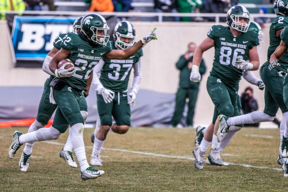 Sophomore cornerback Josiah Scott (22) runs off the field after an interception during the annual Green and White spring game on April 7, 2018 at Spartan Stadium. White defeated Green, 32-30.