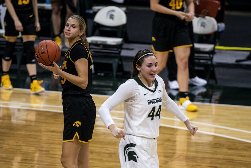 Freshman forward Kendall Bostic (44) excited for the teams win during the game against Iowa on December 12, 2020 at the Breslin Center. The Spartans defeated the Hawkeyes 86-82.