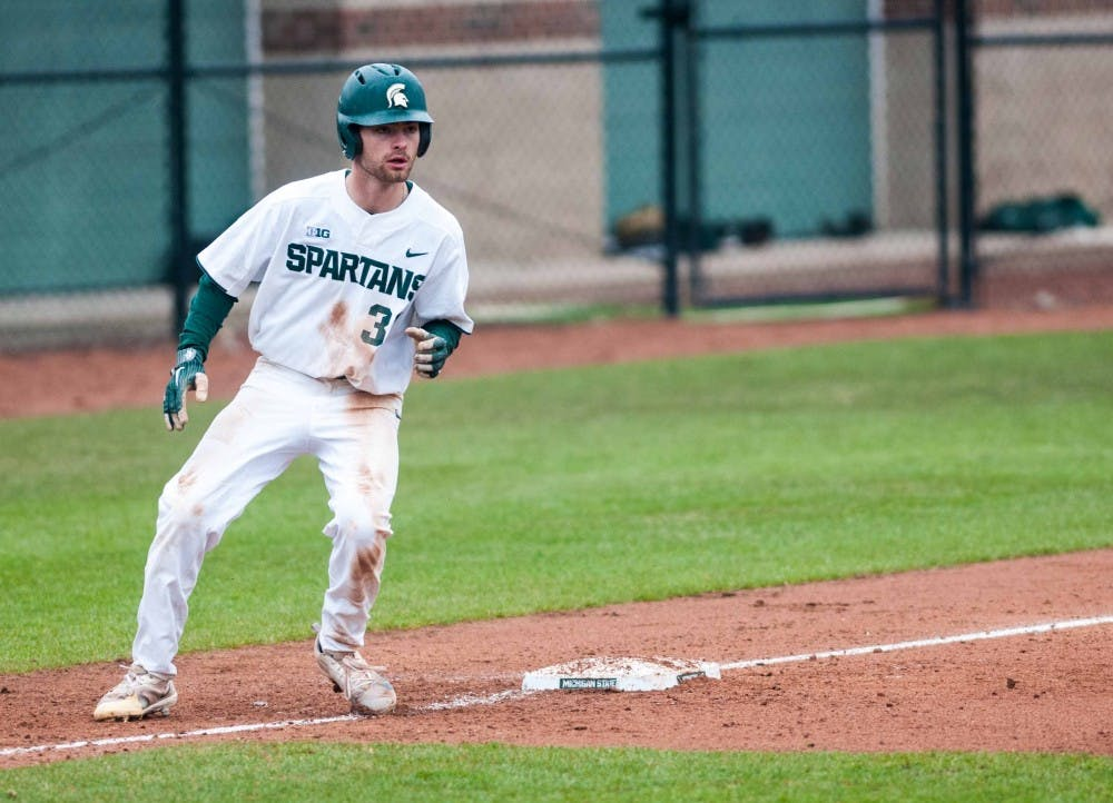 Freshman infielder and outfielder Zach Iverson (32) moves for home base at McLane Baseball Stadium on April 13, 2018. The Spartans fell to the Crusaders, 7-6. (Annie Barker | State News)