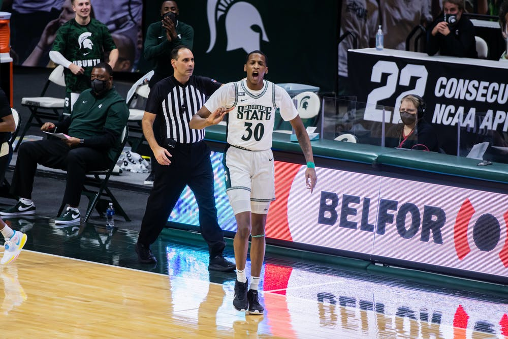 Junior forward Marcus Bingham Jr. celebrates a block during the Spartans' 55-54 loss to Purdue on Jan. 8, 2021.