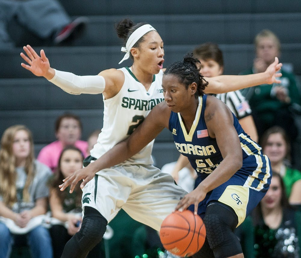 <p>Sophomore forward Aerial Powers guards Georgia Tech forward Zaire O'Neil Dec. 4, 2014, at Breslin Center. The Spartans defeated the Yellow Jackets in overtime, 79-73. Raymond Williams/The State News</p>