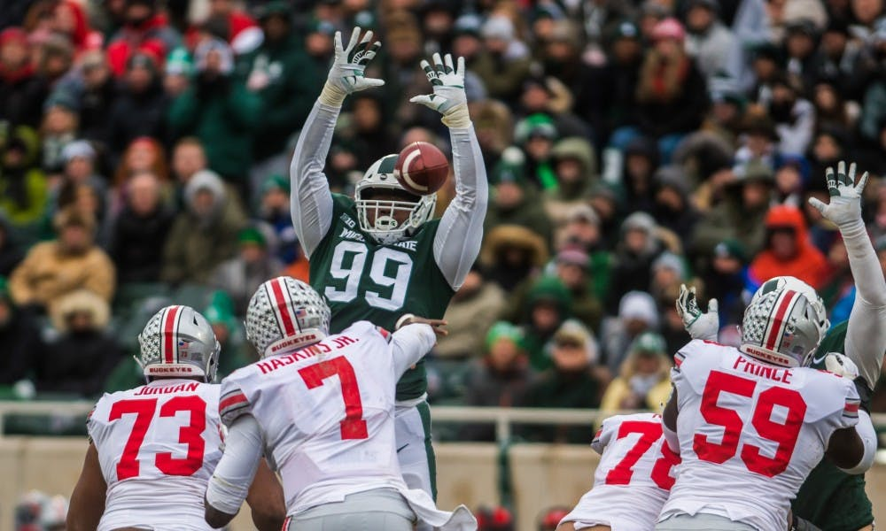 Junior defensive tackle Raequan Williams (99) tries to block a pass during the game against Ohio State at Spartan Stadium on Nov. 10, 2018. The Spartans fell to the Buckeyes, 26-6.