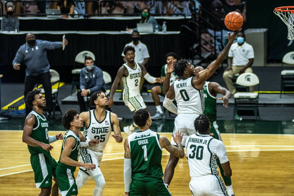 <p>Junior forward Aaron Henry (0) moves to shoot the ball during the game against Eastern Michigan on Nov. 25, 2020, at the Breslin Center. The Spartans defeated the Eagles, 83-67.</p>