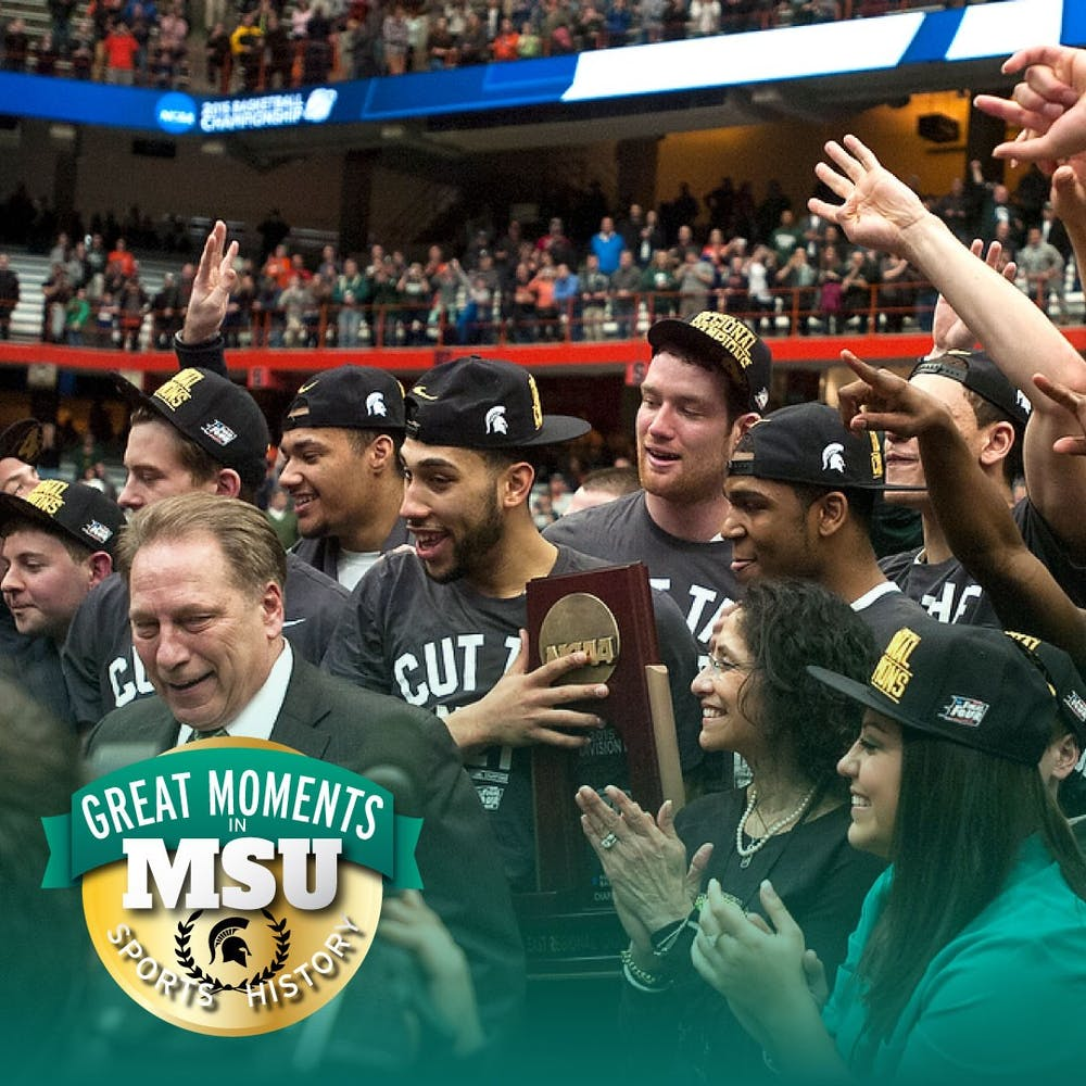 Head coach Tom Izzo, his family and his team celebrate the win with the NCAA East Regional trophy March 29, 2015, during the East Regional round of the NCAA Tournament in the Elite Eight against Louisville at the Carrier Dome in Syracuse, New York. The Spartans defeated the Cardinals, 76-70. Photo by Erin Hampton. Design by Daena Faustino.