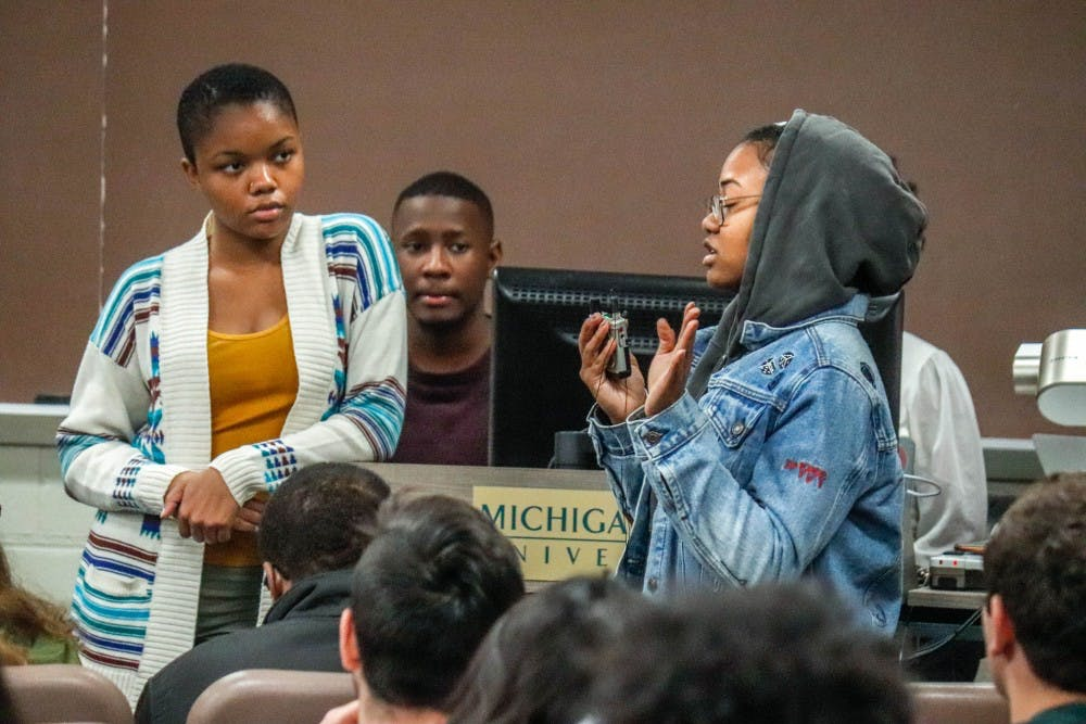<p>BSA Vice President Keilyn Broussard listens to comparative cultures and politics senior Talyce Murray at a BSA Community Forum on Oct. 22, 2019 at Akers Hall.</p>