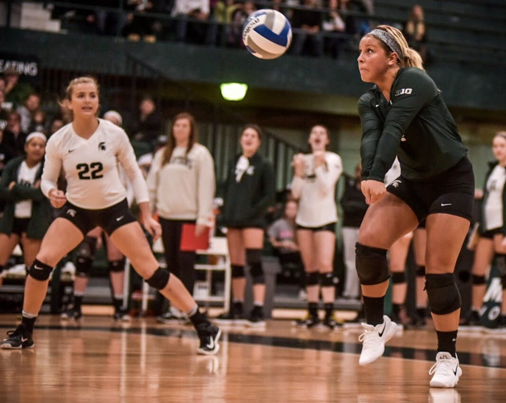 Freshman defensive specialist and libero Jamye Cox (4) hits the ball during the game against Northwestern on Nov. 11, 2017 at Jenison Fieldhouse. The Spartans defeated the Wildcats, 3-0.