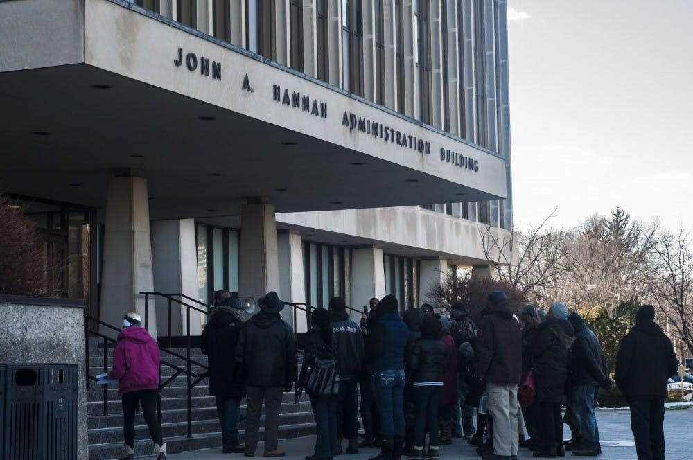 A group of protesters congregate outside of the Hannah Administration Building on March 2, 2018 for a rally lead by the David Alexander Bullock. (Annie Barker | State News)