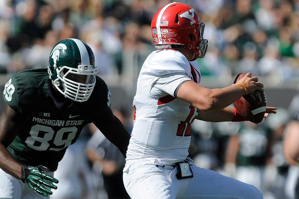 <p>Youngstown State quarterback Kurt Hess steps up in the pocket as sophomore defensive end Shilique Calhoun goes in for the sack Sept. 14, 2013 at Spartan Stadium. The Spartans had a strong showing against Youngstown State in a 55-17 victory. Khoa Nguyen/ The State News</p>