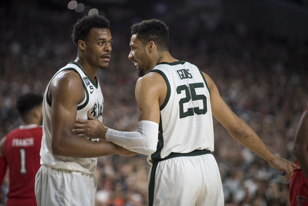 Sophomore forward Xavier Tillman (23) converses with Senior forward Kenny Goins (25) during the first half of the NCAA Final Four game against Texas Tech at U.S. Bank Stadium in Minneapolis on April 6, 2019. (Nic Antaya/The State News)