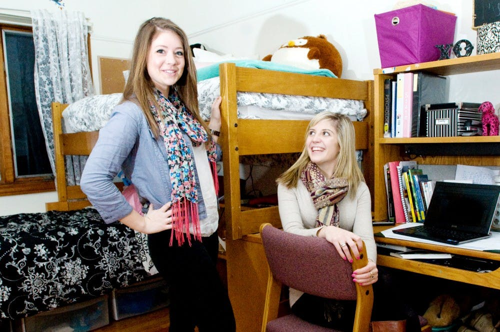 """Sorority sisters advertising sophomore Emily Jaslove, left, and marketing junior Amanda Stowers both live at the Chi Omega sorority house because they wanted a more intimate living setting. """"I like that there are people around all the time. In the dorms there are a lot of people you don't know, but here I live with 47 of my best friends,"""" Jaslove said. Derek Berggren/The State News"""