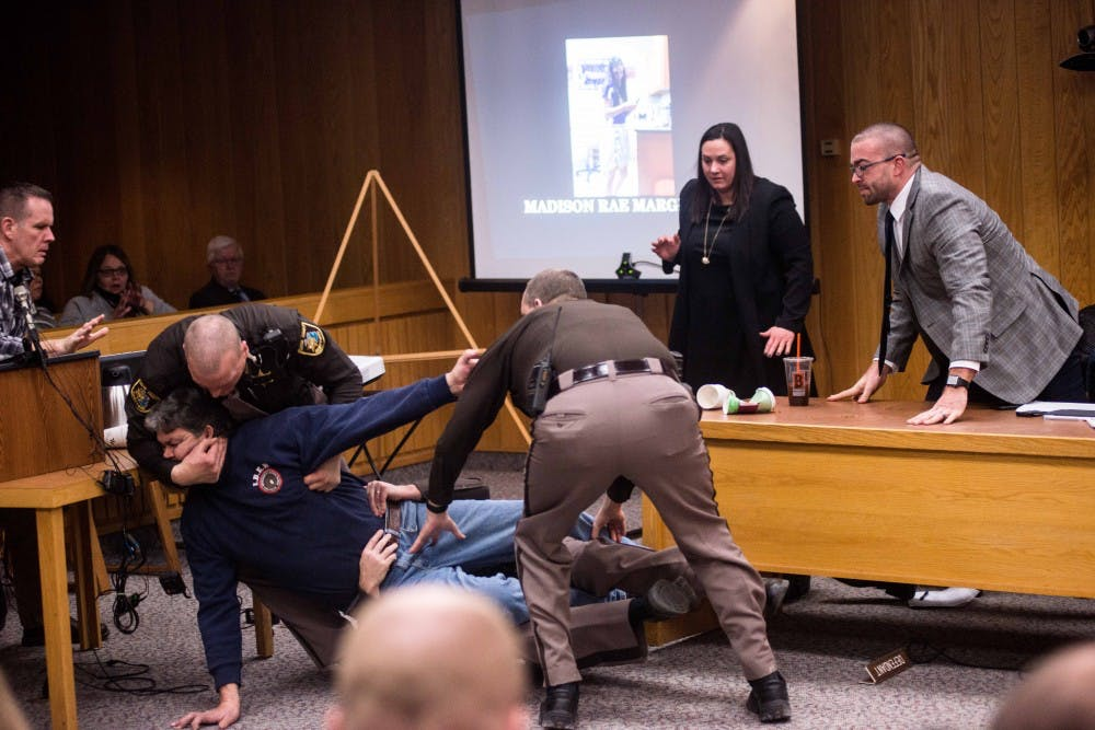 Randal Margraves, father of Madison Rae Margraves and Lauren Margraves, has to be restrained after attempting to attack Nassar on the second day of sentencing for Larry Nassar on Feb. 2, 2018, in the Eaton County courtroom. Nassar faces three counts of criminal sexual conduct in Eaton. (Annie Barker | State News)