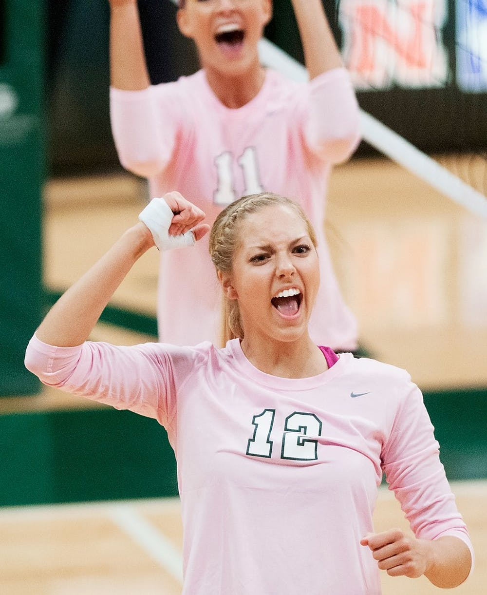<p>Freshman setter Rachel Minarick celebrates after a point Oct. 11, 2014, during the game against Iowa at Jenison Field House. The Spartans defeated the Hawkeyes, 3-0. Jessalyn Tamez/The State News</p>