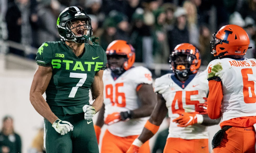 <p>Junior wide receiver Cody White (7) celebrates a catch during the game against Illinois on Nov. 9, 2019 at Spartan Stadium. The Spartans fell to the Fighting Illini, 37-34.</p>