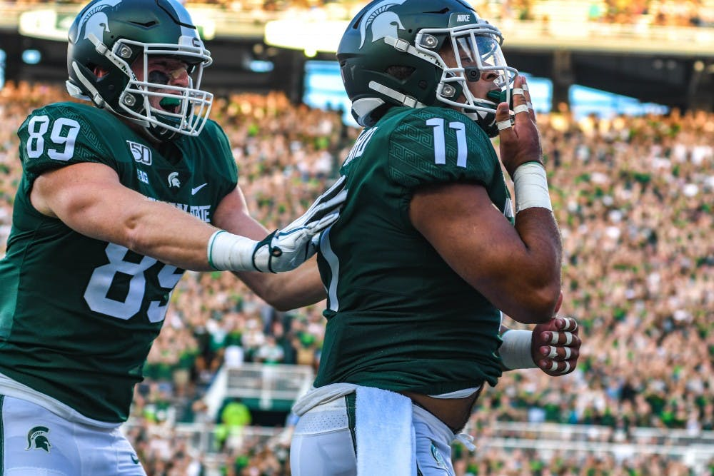 <p>Junior running back Connor Heyward (11) blows a kiss during the game against Tulsa on Aug. 30, 2019 at Spartan Stadium. The Spartans defeated the Golden Hurricane, 28-7.</p>