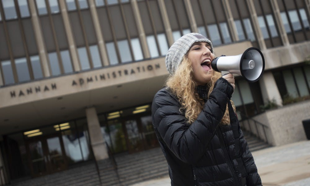 <p>Makenna Carpenter, supply chain management junior, chants in front of the Hannah Administration Building on Oct. 27. Carpenter said that every hate crime that has happened on Michigan State&#x27;s campus is wrong and &quot;dealing with these types of instances is what Michigan State needs to work on.&quot;</p>