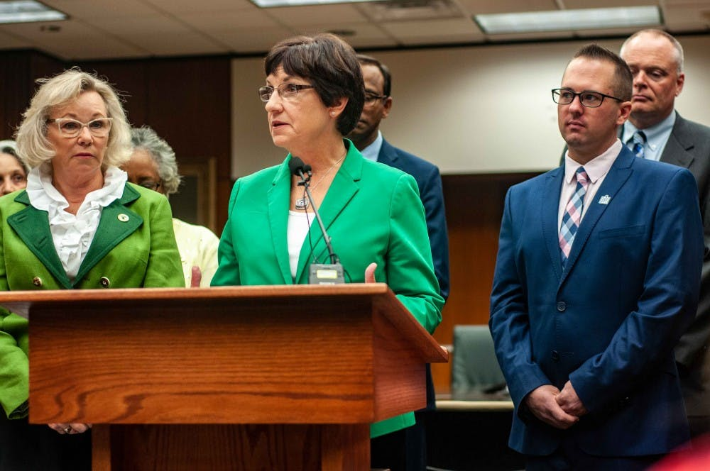 <p>Board of Trustees member Dianne Byrum, right, and Board of Trustees member Melanie Foster, left, speak at the meeting on the update of the presidential search process at the Hannah Administration Building on Aug. 22, 2018.</p>