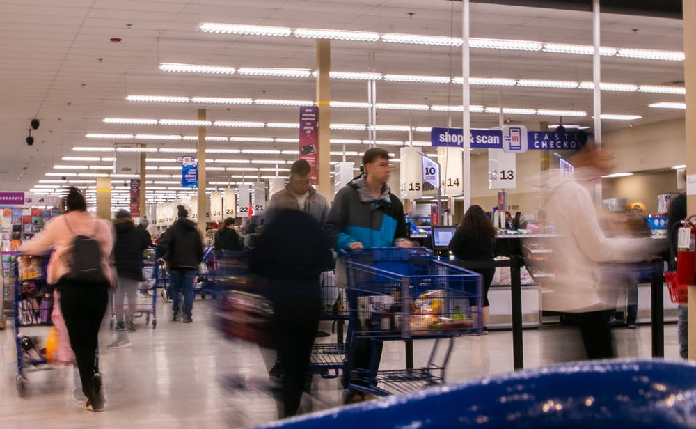 <p>People walk around the checkout aisles at Meijer on March 12, 2020, after MSU canceled classes due to coronavirus.</p>