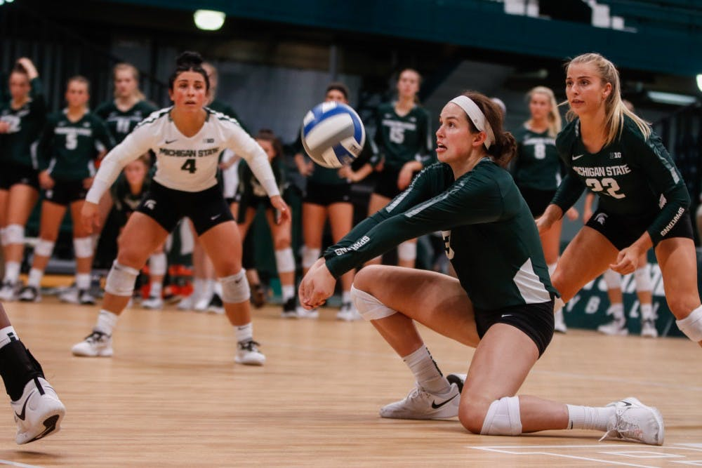 <p>Junior outside hitter Meredith Norris (3) passes a ball during the game against Cincinnati Sept. 6 at Jenison Field House. The Spartans defeated the Bearcats, 3-1.</p>