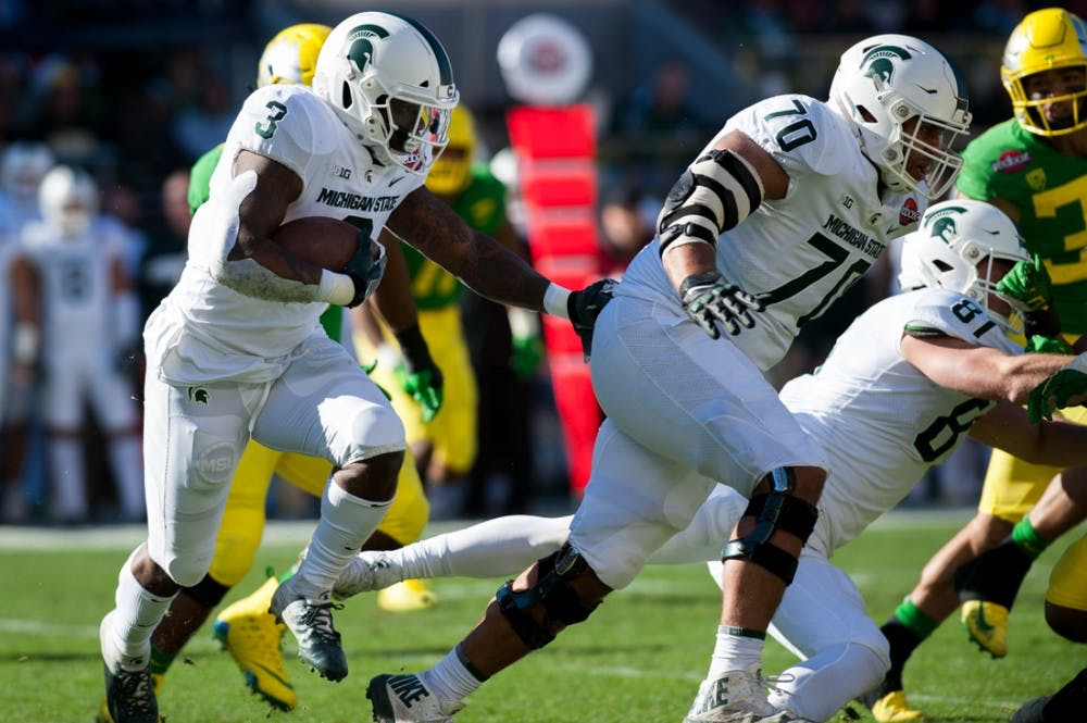 Spartans running back LJ Scott (3) attempts to find a hole in the Ducks defense. Oregon Ducks Football takes on Michigan State University at Levi's Stadium in Santa Clara, CA. on Dec. 31, 2018. (Ben Green/Emerald)