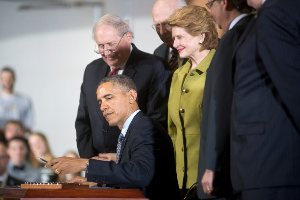 <p>President Barack Obama signs the farm bill into law on Feb. 7, 2014, at the Mary Anne McPhail Equine Performance Center. Direct crop payments are replaced by an insurance program in the farm bill. Julia Nagy/The State News</p>