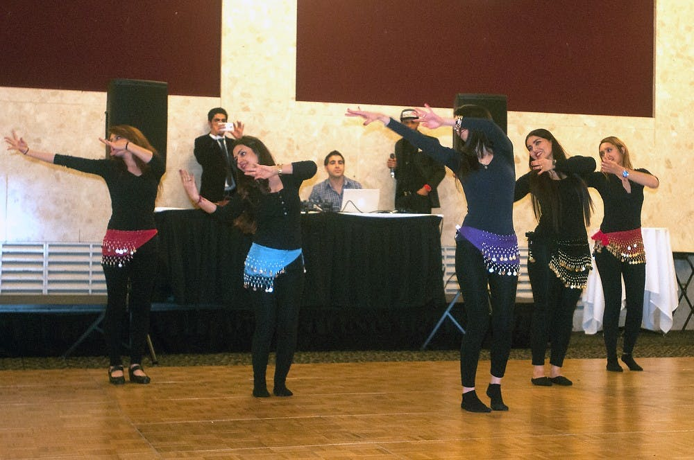 <p>Members of the Persian Student Association perform a traditional dance March 20, 2015, at the MSU Union during their celebration of the Persian New year. Kennedy Thatch/The State News</p>