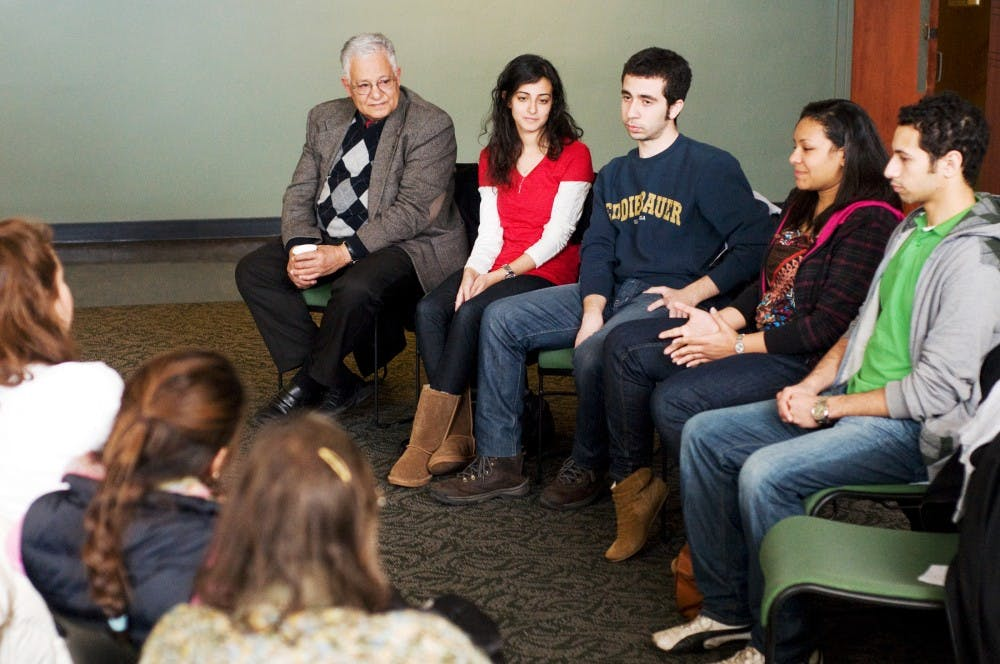 "Four Egyptian exchange students from the University of Chicago, who each took part in the revolution in Tahrir Square in their own way, led a panel discussion Friday in Case Hall. The event, ""Egyptian Youth Revolution: Open Dialogue with Tahrir Square"", was meant to discuss the revolution and compare this to other revolutions in Egypt's history. Kat Petersen/The State News"