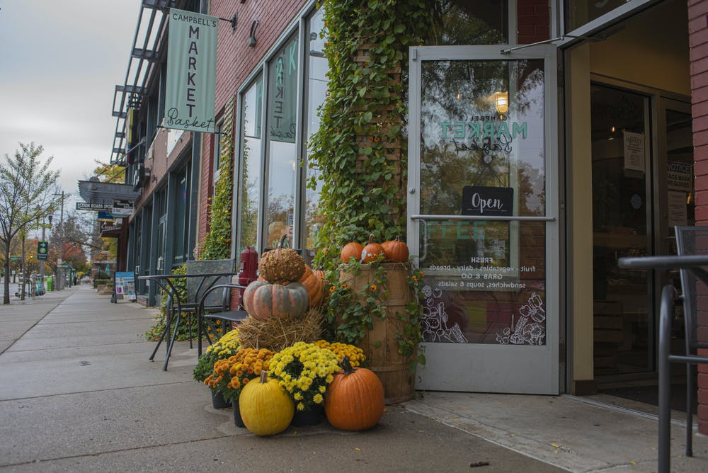 <p>Campbell&#x27;s Market Basket, located on Grand River Avenue, displays pumpkins and fall colored flowers at both entrances. Shot on Oct. 18, 2020.</p>
