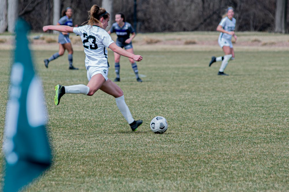 Junior midfielder Sam Sklarski passes the ball down field, during the Spartans' 1-0 overtime loss to the Wildcats on Mar. 25, 2021. The loss was the Spartans' sixth in a row.