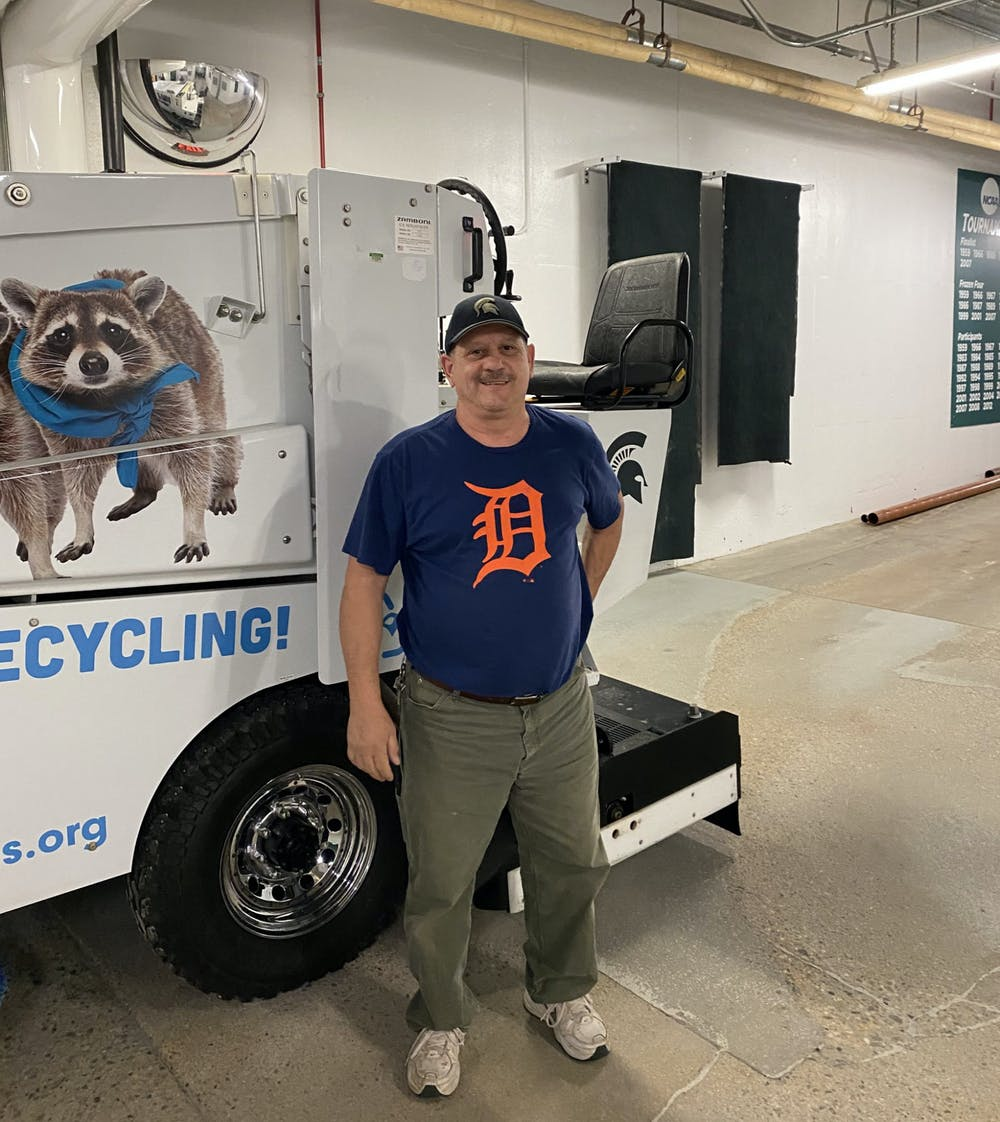 Lou Tomo stands in front of the Zamboni he operated for the past 35 years at Munn Ice Arena on Aug. 27, 2020. Photo courtesy of MSU Hockey