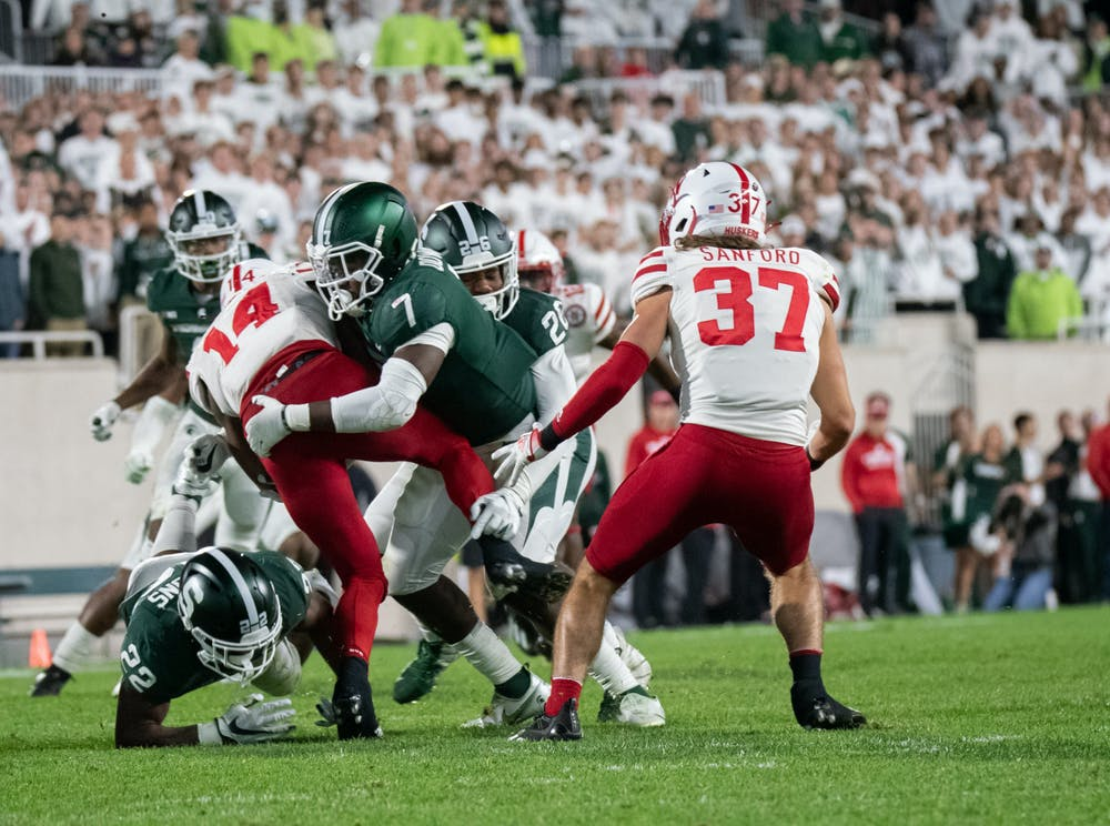 <p>Michigan State&#x27;s redshirt junior safety Michael Dowell (7) tackles Nebraska&#x27;s redshirt freshman running back Rahmir Johnson (14) during Michigan State&#x27;s win against University of Nebraska on Sept. 25, 2021.</p>